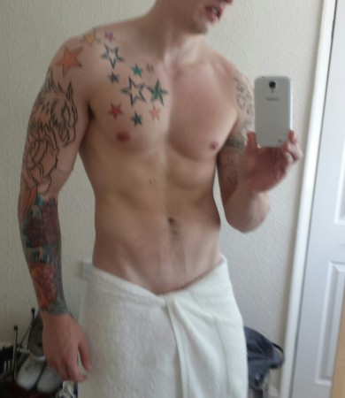Tattooed Muscle Boy With Smooth Cock